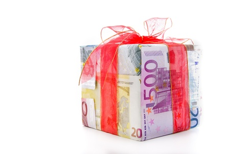 Different euro bills with red ribbon packed as a gift box isolated on a white background photo