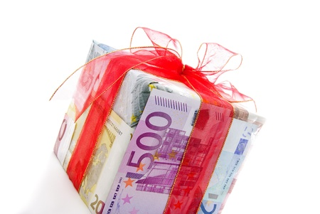 50 euro: Different euro bills with red ribbon packed as a gift box isolated on a white background
