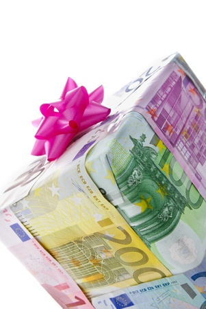 christmas profits: Different euro bills packed as a present isolated on a white background Stock Photo