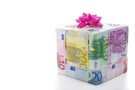 christmas bonus: Different euro bills packed as a present isolated on a white background Stock Photo