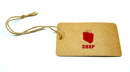 a shopping-bag sign written on a tag tied with a brown string isolated on a white background photo