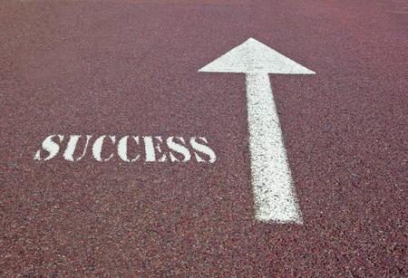 an arrow on the asphalt showing the success direction photo
