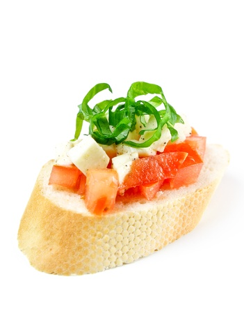 Bruschetta with fresh diced tomatoes, mozzarella and fresh basil isolated on white Stock Photo