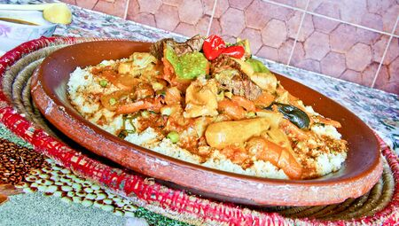 couscous: Moroccan couscous served in the ceramic dish the traditional way