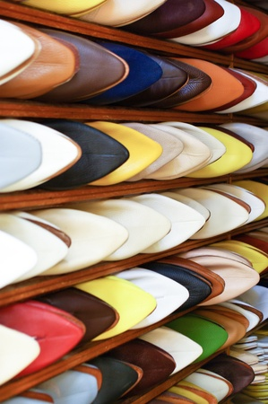 Colorful Moroccan men silppers aligned on a shoe rack in a shop Stock Photo