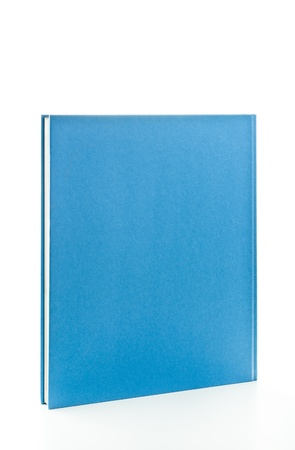 Blank blue book in upright position isolated on white photo