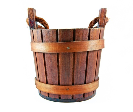 A wooden bucket isolated on white