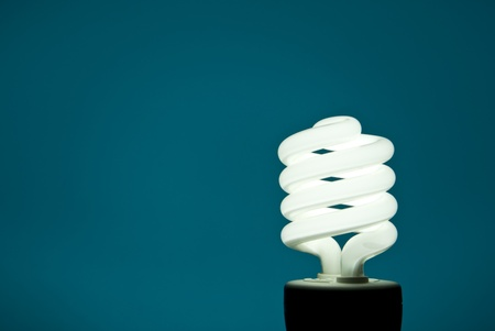 A florescent bulb symbolizing the saving energy of and money photo
