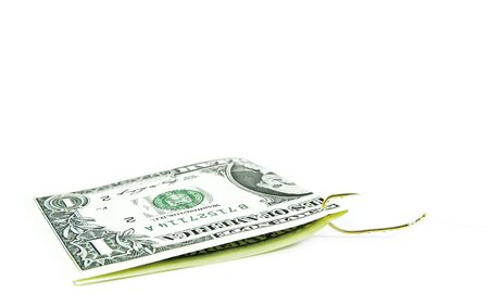 1 dollar bill on a fishhook isolated on a white background photo