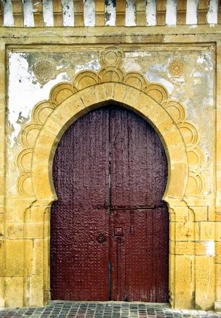 moroccan culture: Moroccan traditional entrance door  gate Stock Photo