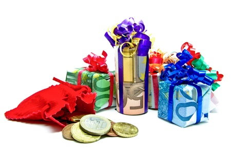 Gifts packed in euro bills on a white background photo