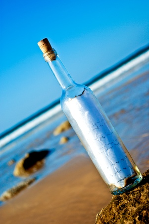 Message in a Bottle at a deserted beach photo