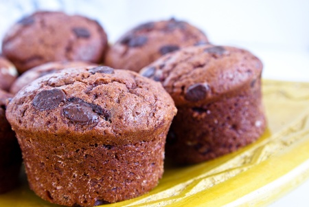 Freshly baked brown chocolate cupcakes close up with shallow dof photo