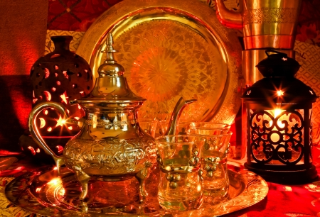 Bedouin tea party set up in a warm oriental candelight  atmosphere photo