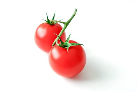 Fresh juicy cherry tomatoes with on a white background Stock Photo