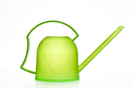 bailer: Green watering pot on a white background