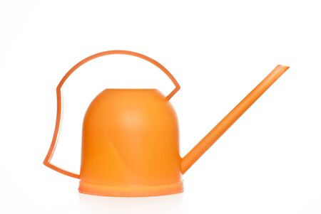 watering pot: Orange watering pot on a white background Stock Photo