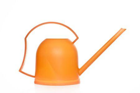 bailer: Orange watering pot on a white background Stock Photo
