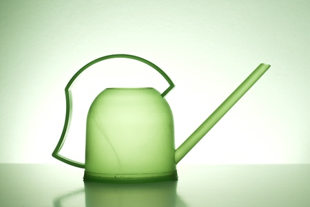 bailer: Green watering can on a green background