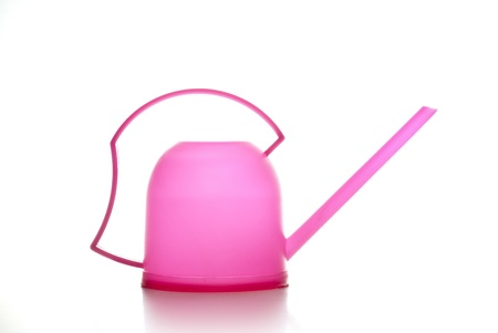 watering pot: Pink watering pot on a white background Stock Photo