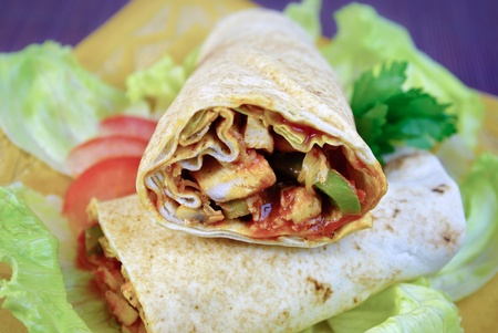 Fresh spicy chicken wraps with vegetables on the plate Stock Photo