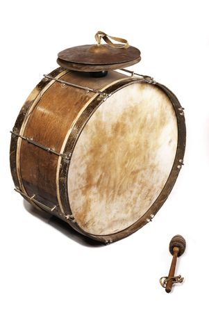 drum: The old, worldly-wise, shabby, dusty bass drum for a wind band and a beater Stock Photo