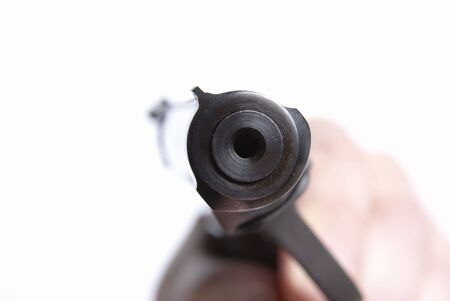 stickup: The pistol directed on you, on a white background, shallow DOF Stock Photo