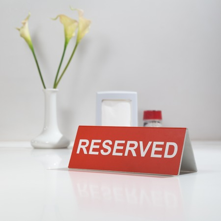 reserved seat: Flawer and sign on the table Reserved