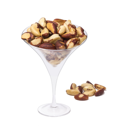 albero nocciolo: Many bertholletia in a glass on white background