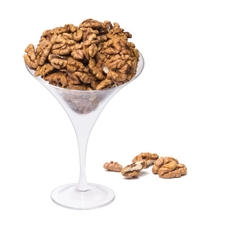 Many walnut in the glass on white background