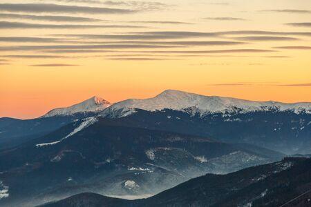 Winter mountains at sunset Stock Photo