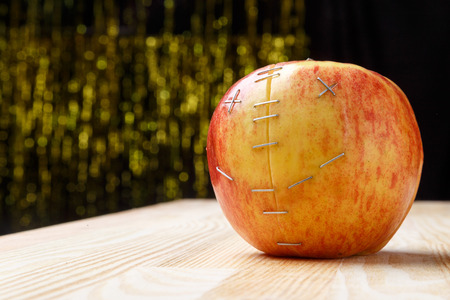 Broken apple, repaired as dead smiley Stock Photo