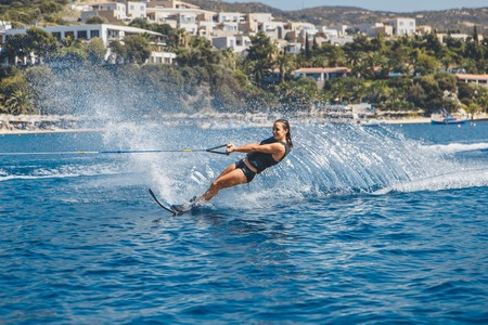 Water skis glides on the waves Stock Photo