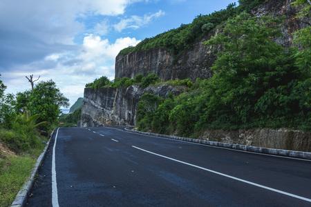 Mountain road above high cliff at Melasti Beach, Ungasan at Bali, Indonesia.