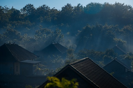 morning on countryside, village in haze, Bali roof, Stock Photo