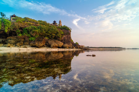 Geger beach and Pura Geger in Nusa Dua, Bali, Indonesia. Tradition Balian temple on cliffe over water Stock Photo