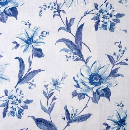 Fragment of colorful retro tapestry textile pattern with floral ornament and flowers useful as background Stock Photo