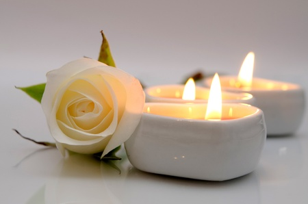 white rose and candles in the shape of heart photo