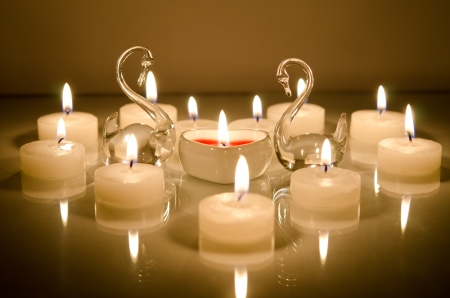 candles in the shape of a heart with swans photo
