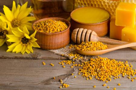Still life of cup of tea,  honey, honeycombs, wax and pollen granule