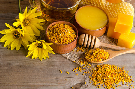 Still life of cup of tea, honey, wax and pollen granule