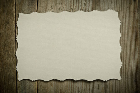 reciprocity: The piece of old white paper lying on a wooden background Stock Photo