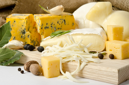scamorza: Various types of cheese with spice on the wooden board
