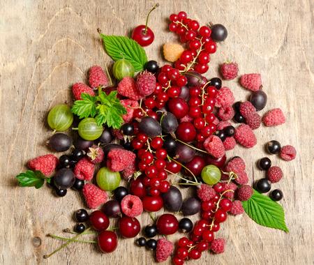 wooden insert: Summer berries on wooden background Stock Photo
