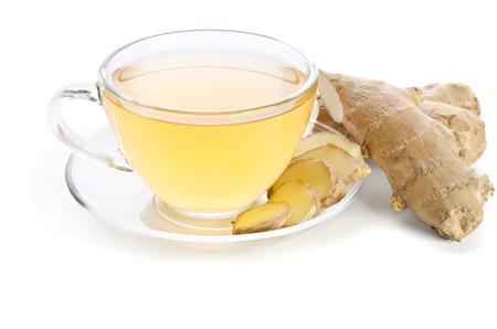 白い背景に分離されたショウガの根とお茶 写真素材