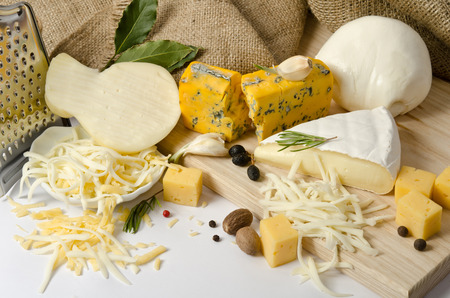 scamorza cheese: the bowl with grated cheese and spices and cheeses around Stock Photo
