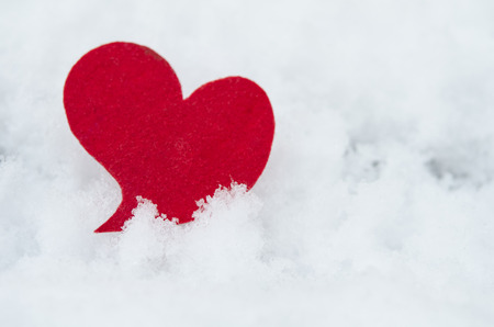 be wet: red heart on ice wet snow,  outdoors image