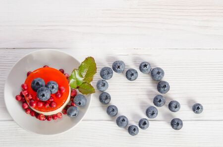 whipped: Frame- heart from blueberry  and fruitcake on wooden table   top view empty space for text