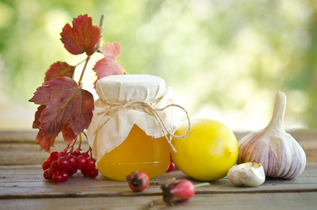 flue season: Honey and others natural medicine for winter flue, on wooden table