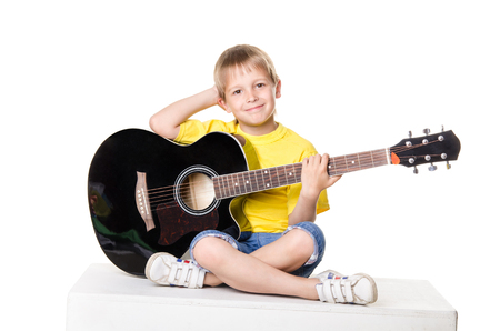 lotos: boy sitting with guitar in lotos pose isolated on a over white background Stock Photo